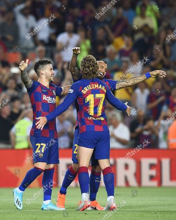 Arturo Vidal of FC Barcelona celebrates his goal (5-1) with his teammates Antoine Griezmann and Carlos Perez