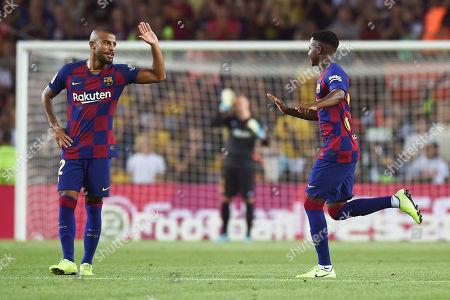 Rafinha Alcántara of FC Barcelona grets his teammate Ansu Fati