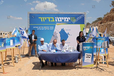 Stock Image of Ayelet Shaked (R), chairman of the Union Party 'Yemina' (Right), Israeli Transport Minister and leader of 'Yemina' party, Bezalel Smotrich (C-R) Israeli Education Minister and leader of 'Yemina' party Rafi Peretz (L) and former Education Minister and  Party leader Naftali Bennett (C) during a press conference as they launch the party housing solution plan as part of their election campaign in the under construction residential neighborhood Ramat Elkana in israeli settlement of Elkana located  in the north-western Samarian hills in the West Bank, 21 August 2019. Right-wing party 'Yemina' leaders launched the party's housing solution plan proposed by the party leaders. The plan is aimed to encourage half a million Israelis living in the central part of the country to move to the northern West Bank Israeli settlements.