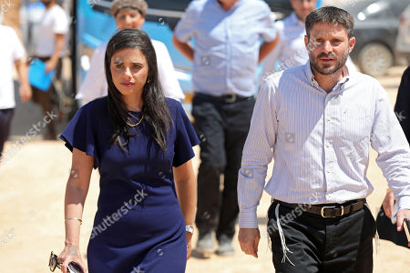 Stock Photo of Ayelet Shaked (L), chairman of the Union Party 'Yemina' and Israeli Transport Minister and leader of 'Yemina' party, Bezalel Smotrich (R) attend a press conference as they launch the party housing solution plan as part of their election campaign in the under construction residential neighborhood Ramat Elkana in israeli settlement of Elkana located  in the north-western Samarian hills in the West Bank, 21 August 2019. Right-wing party 'Yemina' leaders launched the party's housing solution plan proposed by the party leaders. The plan is aimed to encourage half a million Israelis living in the central part of the country to move to the northern West Bank Israeli settlements.