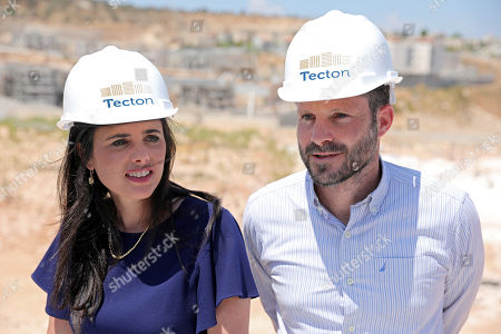 Ayelet Shaked (L), chairman of the Union Party 'Yemina' (Right ) and Israeli Transport Minister and leader of 'Yemina' party, Bezalel Smotrich (R) attend a press conference as they launch the party housing solution plan as part of their election campaign in the under construction residential neighborhood Ramat Elkana in israeli settlement of Elkana located  in the north-western Samarian hills in the West Bank, 21 August 2019. Right-wing party 'Yemina' leaders launched the party's housing solution plan proposed by the party leaders. The plan is aimed to encourage half a million Israelis living in the central part of the country to move to the northern West Bank Israeli settlements.