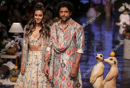 Bollywood celebrities Shibani Dandekar (L) and Farhan Akhtar (R) present creations by Indian designer Payal Singhal during the Lakme Fashion Week (LFW) Winter/Festive 2019 in Mumbai, India, 21 August 2019. More than 75 designers are showcasing their collections until 25 August.