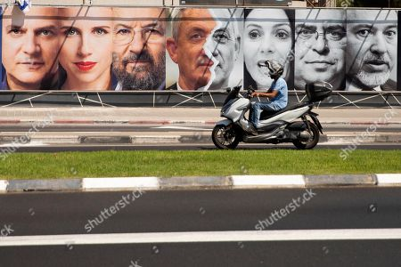 Stock Picture of Israeli politicians from left, Nitzan Horowitz, Stav Shaffir, Ehud Barak, Benny Gantz, Miri Regev, David Bitan and Avigdor Lieberman are seen in an elections billboard in Tel Aviv, Israel