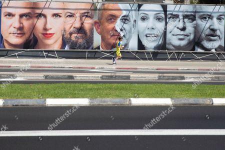 Israeli Politicians from left, Nitzan Horowitz, Stav Shaffir, Ehud Barak, Benny Gantz, Miri Regev, David Bitan and Avigdor Lieberman are seen in an elections billboard in Tel Aviv, Israel, Wednesday, Aug. 21,2019