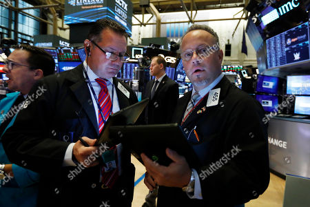 Edward Curran, Robert Arciero. Traders Edward Curran, center, and Robert Arciero, right, work on the floor of the New York Stock Exchange, . Stocks are rising broadly in early trading on Wall Street as investors applauded encouraging quarterly results from major retailers