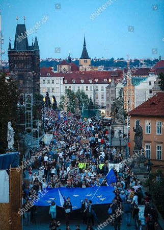 Czechs march carrying a large European Union flag across the medieval Charles Bridge downtown Prague, Czech Republic, . Thousands marched to mark the anniversary of the 1968 Soviet-led invasion of Czechoslovakia and to reflect on current political situation