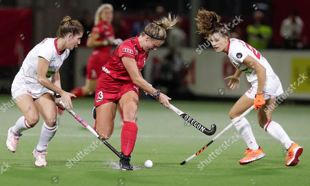 (L-R) Carlota Petchame of Spain, Alix Gerniers of Belgium and Lucia Jimenez of Spain in action during the EuroHockey 2019 Women match between Belgium and Spain in Antwerp, Belgium, 21 August 2019.