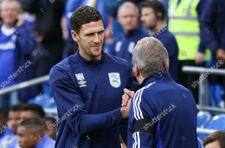 Huddrsfield Town caretaker manager Mark Hudson greets Cardiff City manager Neil Warnock at the start of the match