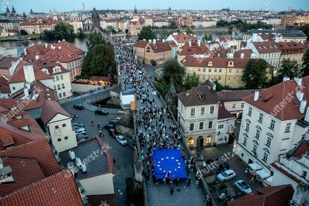 Thousands of demonstrators march to protest against Czech Prime Minister Andrej Babis, Czech President Milos Zeman, and current political situation marking the 51st anniversary of the Soviet-led occupation of former Czechoslovakia, on the Charles Bridge in Prague, Czech Republic, 21 August 2019. Czech and Slovak people mark on 21 August the 51st anniversary of the Soviet-led invasion in Czechoslovakia in 1968 that crushed the liberal reforms and ended an era known as the 'Prague Spring'. Soviet troops occupied Czechoslovakia until 1990.