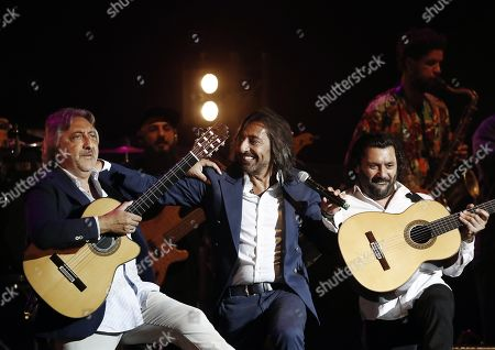 Stock Image of Spanish flamenco band Ketama's lead singer Antonio Carmona (C) and his brothers Jose Miguel Carmona (R) and Juan Carmona (L) performon stage during the band's concert in Pamplona, Spain, 21 August 2019, on occasion of the Flamenco on Fire Festival in Navarra.