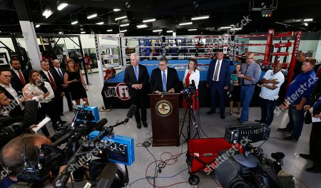Attorney General William Barr (C) along with Senator John Cornyn (L) talks with media at the North Lake Highlands Youth Boxing Gym in Dallas, Texas, USA, 21 August 2019. Attorney General William Barr is in Dallas, Texas to promote Project Safe Neighborhoods.