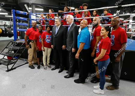 Attorney General William Barr (CL) along with Senator John Cornyn (CR) pose for a picture with children and staff from the gym after talking with media at the North Lake Highlands Youth Boxing Gym in Dallas, Texas, USA, 21 August 2019. Attorney General William Barr is in Dallas, Texas to promote Project Safe Neighborhoods.
