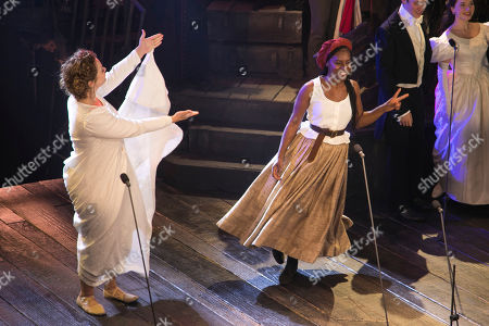 Stock Photo of Carrie Hope Fletcher (Fantine) and Shan Ako (Eponine) during the curtain call