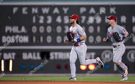 Bryce Harper, Corey Dickerson. Philadelphia Phillies right fielder Bryce Harper, left, and left fielder Corey Dickerson head to the clubhouse after the team's win over the Boston Red Sox in a baseball game at Fenway Park in Boston, . The Phillies won 5-2