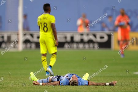Ronald Matarrita, Luis Diaz. New York City FC defender Ronald Matarrita lies on the pitch as Columbus Crew midfielder Luis Diaz walks toward Columbus goalkeeper Elroy Room, back right, at the conclusion of an MLS soccer match, in New York. NYCFC won 1-0