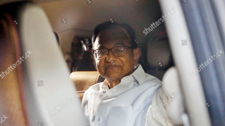 Stock Picture of CBI officials take away Congress leader and former Union Minister P. Chidambaram from his residence. Former Finance Minister P. Chidambaram was arrested by the CBI Wednesday night from his residence in connection with INX media corruption case after dramatic developments with the agency sleuths scaling walls to gain access to the bungalow in the high-end Jor Bagh locality. The CBI which was looking for 73-year old Chidambaram since Tuesday after his anticipatory bail application was rejected by the Delhi High Court managed to get a whiff of his location only when he appeared on camera at the Congress headquarters in the evening to make a press statement. The agency sources said that he will be produced in the Prevention of Money Laundering Act.
