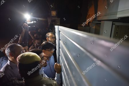 Stock Image of CBI and ED officials try to enter the residence of P Chidambram. Former Finance Minister P. Chidambaram was arrested by the CBI Wednesday night from his residence in connection with INX media corruption case after dramatic developments with the agency sleuths scaling walls to gain access to the bungalow in the high-end Jor Bagh locality. The CBI which was looking for 73-year old Chidambaram since Tuesday after his anticipatory bail application was rejected by the Delhi High Court managed to get a whiff of his location only when he appeared on camera at the Congress headquarters in the evening to make a press statement. The agency sources said that he will be produced in the Prevention of Money Laundering Act.