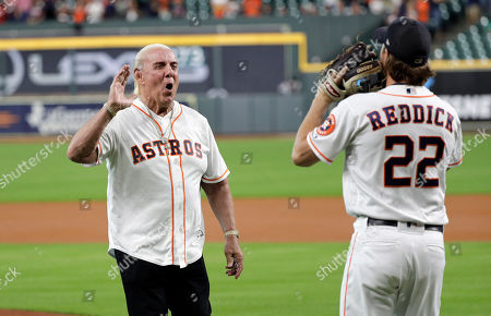 Former professional wrestler Ric Flair, left, greets Houston Astros right fielder Josh Reddick (22) after throwing out the ceremonial first pitch before a baseball game against the Detroit Tigers, in Houston
