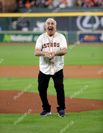 Former professional wrestler Richard Fliehr throws out the ceremonial first pitch before a baseball game between the Detroit Tigers and Houston Astros, in Houston