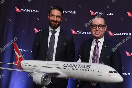QANTAS Group CEO Alan Joyce (R) and CFO Tino La Spina (L) speak to the media as QANTAS Group delivers their full year results in Sydney, Australia, 22 August 2019. According to media reports, QANTAS posted a 6.5 percent fall in profits, sighting an increase in the cost of oil as the primary reason for the shortfall.