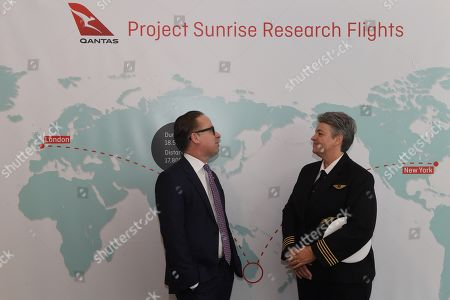 QANTAS Group CEO Alan Joyce (L) joins Fleet Manager B787-9, Captain Lisa Norman (R) in front of the Project Sunrise amp following the QANTAS Group full year results announcement in Sydney, Australia, 22 August 2019. According to media reports, QANTAS posted a 6.5 percent fall in profits, sighting an increase in the cost of oil as the primary reason for the shortfall.
