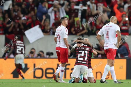 Stock Image of Filipe Luis (C) of Flamengo celebrates a goal during the Copa Libertadores soccer match between Flamengo and Internacional at Maracana Stadium in Rio de Janeiro, Brazil, 21 August 2019.