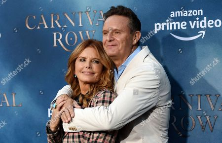 """Mark Burnett, Roma Downey. Producer Mark Burnett, right, and his wife, actress Roma Downey, pose together at the premiere of the Amazon Prime Video series """"Carnival Row"""" at the TCL Chinese Theatre, in Los Angeles"""