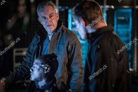 Danny Huston as Wade Jennings and Frederick Schmidt as Travis Cole