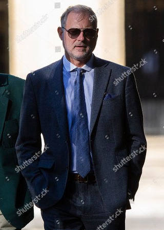 John Leslie arrives at Southwark Crown Court. The former BBC Blue Peter presenter is expected to enter a plea in connection with a charge of sexual assault dating from 2008.