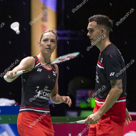 Stock Photo of England's Gabrielle Adcock (L) and Chris Adcock during their mixed doubles round of sixteen match against Japan's Arisa Higashino and Yuta Watanabe at the BWF Badminton World Championships in Basel, Switzerland, 22 August 2019.