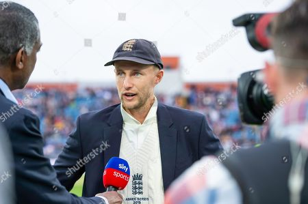England captain Joe Root interviewd by Michael Holding after winning the coin toss and electing to bowl first.