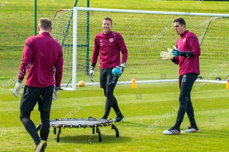 Stock Photo of Goalkeepers Joel Pereira (#23) and Colin Doyle (#13) of Heart of Midlothian FC during training ahead of the Scottish Premiership match between Celtic vs Heart of Midlothian at The Oriam, Scotland's National Performance Centre, Heriot-Watt University, Edinburgh
