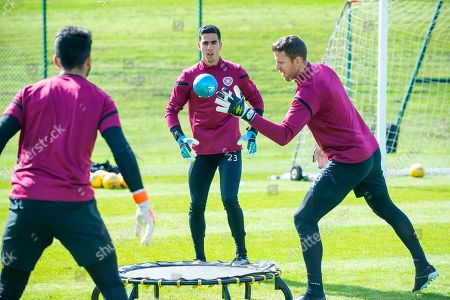 Goalkeepers Joel Pereira (#23) and Colin Doyle (#13) of Heart of Midlothian FC during training ahead of the Scottish Premiership match between Celtic vs Heart of Midlothian at The Oriam, Scotland's National Performance Centre, Heriot-Watt University, Edinburgh