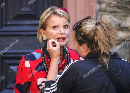Uschi Glas have her make up done prior to a press conference of the movie 'Max and die Wilde 7' in the castle of Braunfels, Germany, 22 August 2019. The filming of 'Max and die Wilde 7' started on 16 July 2019 and will take place in Hesse until the end of August. The cinema adventure is based on the popular award-winning book series by Lisa-Marie Dickreiter and Winfried Oelsner, who is a director too.