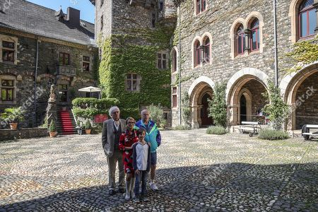 Stock Picture of German actors Guenther Maria Halmer (L) Thomas Thieme (R) Uschi Glas (C-L) and Joan Eisenblaetter (C-R) pose for photographers prior to a press conference of the movie 'Max and die Wilde 7' in the castle of Braunfels, Germany, 22 August 2019. The filming of 'Max and die Wilde 7' started on 16 July 2019 and will take place in Hesse until the end of August. The cinema adventure is based on the popular award-winning book series by Lisa-Marie Dickreiter and Winfried Oelsner, who is a director too.