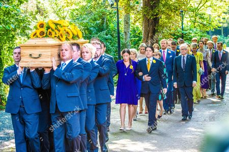 Stock Picture of Juliana Guillermo and Bernardo Guillermo, Pieter Van Vollenhoven, King Willem-Alexander, Queen Maxima, Princess Mabel, Prince Constantijn and Princess Laurentien during the funeral procession from the Dome of Fagel to the Coach House on the grounds of Noordeinde Palace