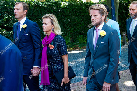 Albert Brenninkmeijer, Princess Carolina and Prince Pieter-Christiaan during the funeral procession from the Dome of Fagel to the Coach House on the grounds of Noordeinde Palace