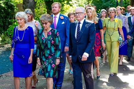 Stock Photo of Princess Irene, Princess Margriet, Pieter Van Vollenhoven, King Willem-Alexander, Queen Maxima during the funeral procession from the Dome of Fagel to the Coach House on the grounds of Noordeinde Palace