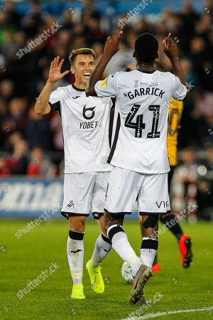 Jordon Garrick of Swansea City celebrates scoring his teams fourth goal with Tom Carroll