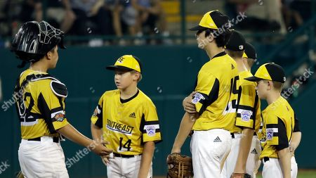 Stock Picture of South Riding, Virginia's Justin Lee, left, Brody Harris (14), Brady Yates (15) and Matt Coleman meet on the mound against Wailuku, Hawaii during the third inning of a baseball game at the Little League World Series tournament in South Williamsport, Pa