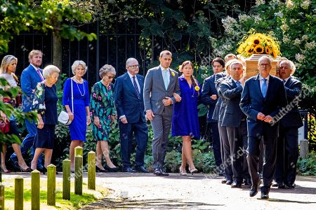 Members of the royal family accompany the coffin with Princess Christina who is transferred from the Dome of Fagel to the Coach House on the grounds of Noordeinde Palace.