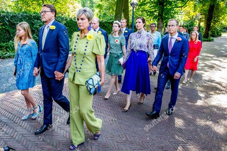 Stock Picture of Princess Laurentien and Prince Constantijn and Leonore  Albert Brenninkmeijer and Princess Carolina Brenninkmeijer de Bourbon de Parme, Princess Margarita Maria Beatriz of Bourbon-Parma and Tjalling ten Cate, Prince Jaime of Bourbon-Parma and Princess Viktoria de Bourbon de Parme, Prince Carlos of Bourbon-Parma and Princess Annemarie accompany the coffin with Princess Christina who is transferred from the Dome of Fagel to the Coach House on the grounds of Noordeinde Palace.