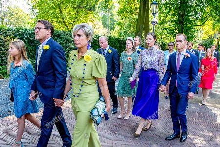 Stock Photo of Princess Laurentien and Prince Constantijn and Leonore  Albert Brenninkmeijer and Princess Carolina Brenninkmeijer de Bourbon de Parme, Princess Margarita Maria Beatriz of Bourbon-Parma and Tjalling ten Cate, Prince Jaime of Bourbon-Parma and Princess Viktoria de Bourbon de Parme, Prince Carlos of Bourbon-Parma and Princess Annemarie accompany the coffin with Princess Christina who is transferred from the Dome of Fagel to the Coach House on the grounds of Noordeinde Palace.