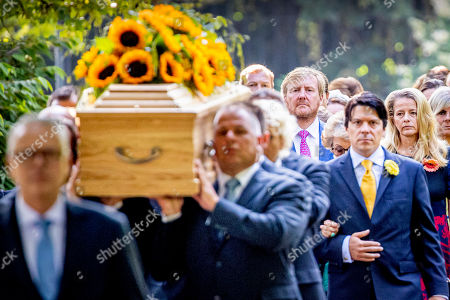 King Willem-Alexander accompany the coffin with Princess Christina who is transferred from the Dome of Fagel to the Coach House on the grounds of Noordeinde Palace.