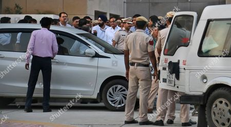 Former Indian finance minister Palaniappan Chidambaram, center, comes out from a special court in New Delhi, India, . An Indian court has ordered that the former finance minister belonging to the opposition Congress party be held for four days for police questioning in suspected bribery and money laundering cases