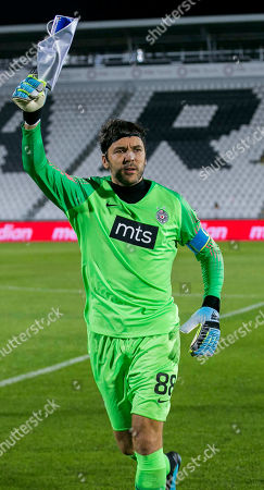 Goalkeeper Vladimir Stojkovic of Partizan waves to the teams fans