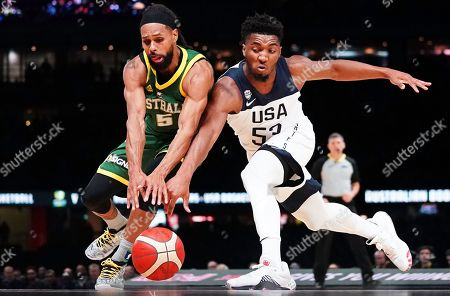 Patty Mills (L) of Australia in action against Donovan Mitchell (R) of the USA during match 1 of the Pre-FIBA World Cup series between Australia and the USA at Marvel Stadium in Melbourne, Australia, 22 August 2019.