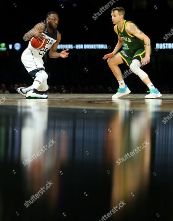 Kemba Walker of the USA (L) in action against Nathan Sobey of Australia during match 1 of the Pre-FIBA World Cup series between Australia and the USA at Etihad Stadium in Melbourne, Australia, 22 August 2019.