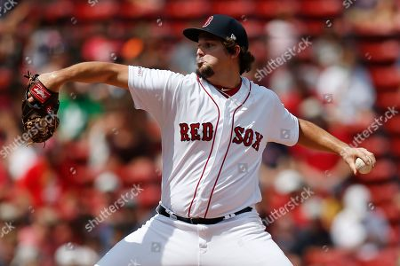Boston Red Sox's Josh Taylor pitches during the 10th inning of a baseball game against the Kansas City Royals that was suspended by rain with the scored tied on Aug. 8, and continued at Fenway Park in Boston, . The Red Sox beat the Royals 5-4