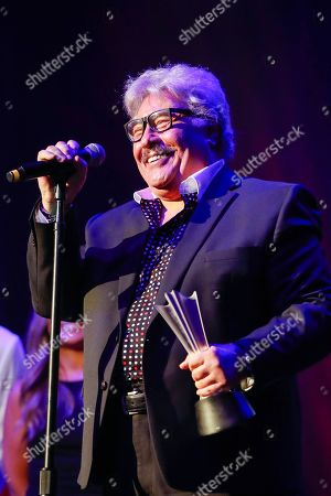 Tony Orlando accepts the Mohegan Sun Arena Casino of the Year award at the 13th Annual ACM Honors at the Ryman Auditorium on in Nashville, Tenn